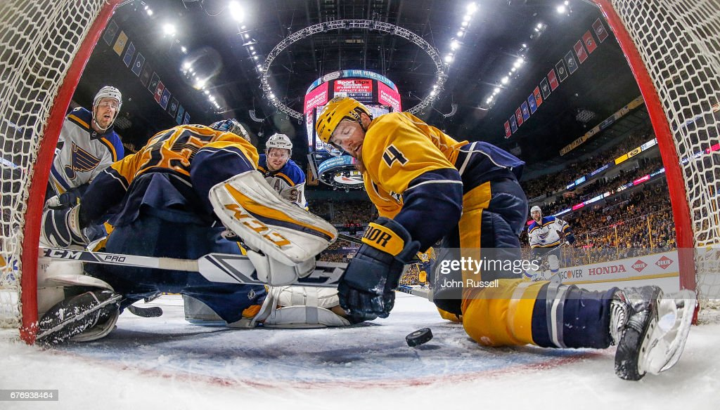 Ryan Ellis #4 makes a save in the crease with Pekka Rinne #35 of the Nashville Predators against Vladimir Tarasenko #91and Jaden Schwartz #17 of the St. Louis Blues in Game Four of the Western Conference Second Round during the 2017 NHL Stanley Cup Playoffs at Bridgestone Arena on May 2, 2017 in Nashville, Tennessee.