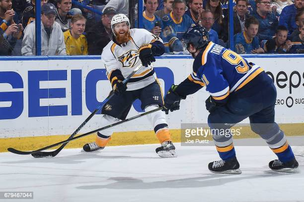Ryan Ellis of the Nashville Predators attempts to clear the puck as Vladimir Tarasenko of the St Louis Blues pressures in Game Five of the Western...