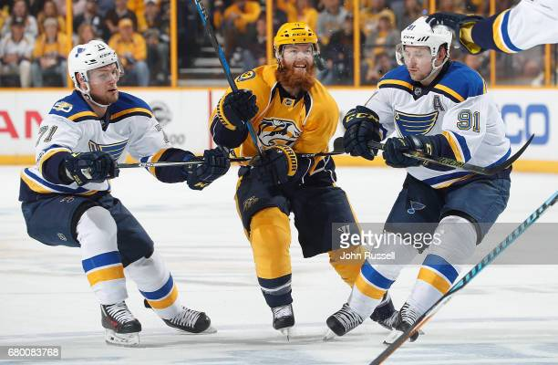 Ryan Ellis of the Nashville Predators battles between Vladimir Tarasenko and Vladimir Sobotka of the St Louis Blues in Game Six of the Western...