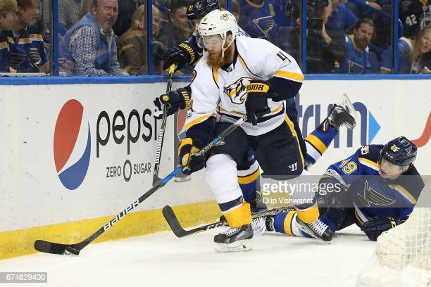 Ryan Ellis of the Nashville Predators beats Ivan Barbashev of the St Louis Blues to the puck in Game Two of the Western Conference Second Round...