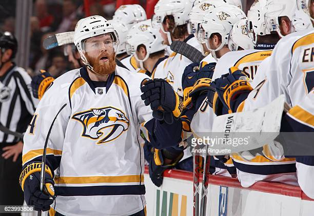 Ryan Ellis of the Nashville Predators celebrates his first period goal against the Ottawa Senators at the players bench at Canadian Tire Centre on...