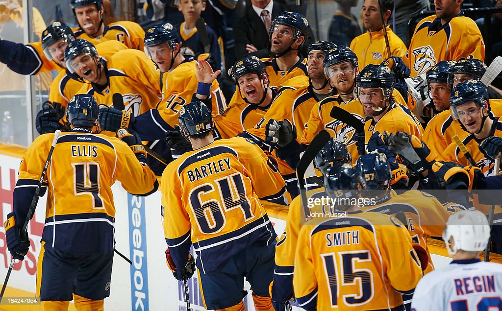 <a gi-track='captionPersonalityLinkClicked' href=/galleries/search?phrase=Ryan+Ellis&family=editorial&specificpeople=4616112 ng-click='$event.stopPropagation()'>Ryan Ellis</a> #4 of the Nashville Predators celebrates his game winning goal against of the New York Islanders at Bridgestone Arena on October 12, 2013 in Nashville, Tennessee.