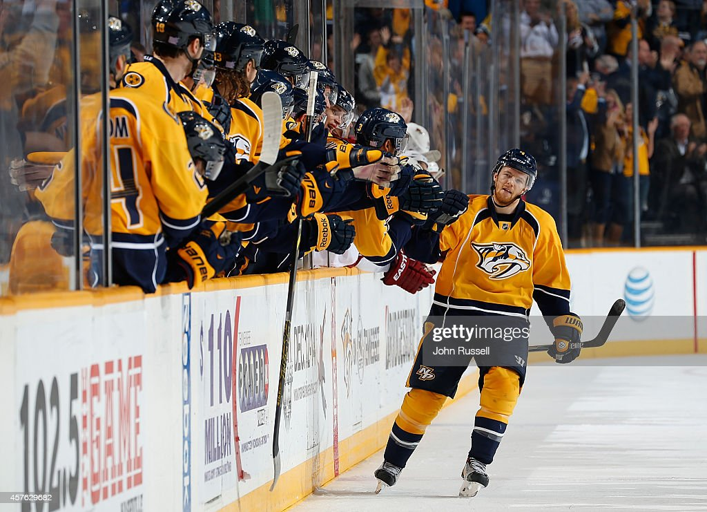Ryan Ellis #4 of the Nashville Predators celebrates his shootout game-winning goal with the bench against the Arizona Coyotes at Bridgestone Arena on October 21, 2014 in Nashville, Tennessee.