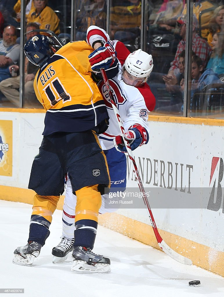 Ryan Ellis #4 of the Nashville Predators checks Alex Galchenyuk #27 of the Montreal Canadiens during an NHL game at Bridgestone Arena on March 24, 2015 in Nashville, Tennessee.