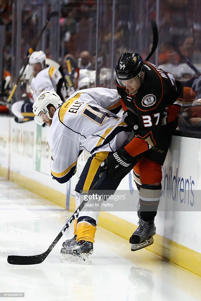 Ryan Ellis #4 of the Nashville Predators checks Nick Ritchie #37 of the Anaheim Ducks during the third period of a game at Honda Center on October 26, 2016 in Anaheim, California.