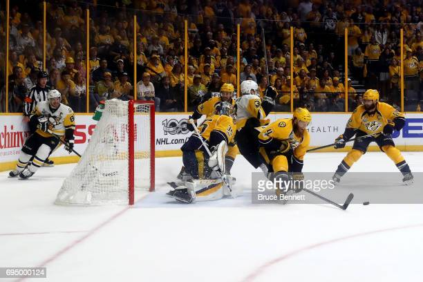Ryan Ellis of the Nashville Predators goes for the rebound against Olli Maatta of the Pittsburgh Penguins during the second period in Game Six of the...