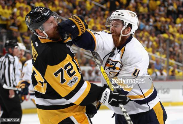 Ryan Ellis of the Nashville Predators hits Patric Hornqvist of the Pittsburgh Penguins during the third period of Game Two of the 2017 NHL Stanley...