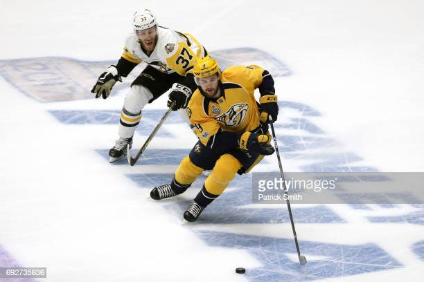 Ryan Ellis of the Nashville Predators is pursued by Carter Rowney of the Pittsburgh Penguins during the first period of Game Four of the 2017 NHL...