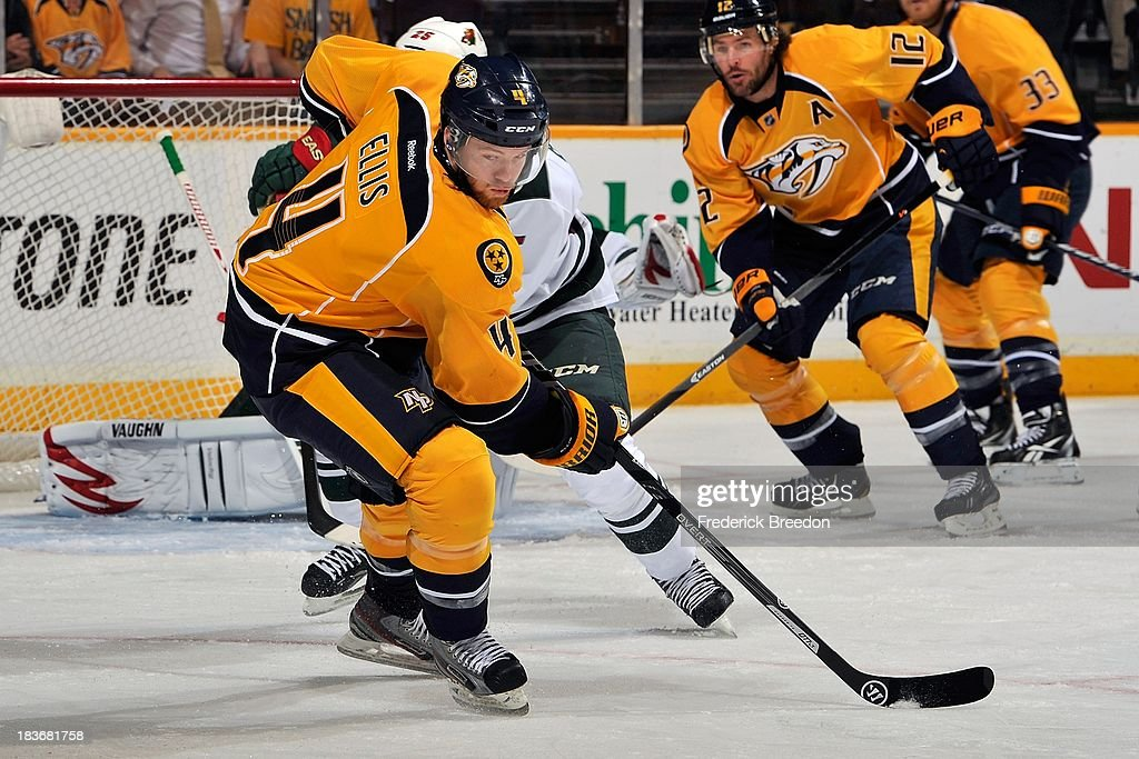 <a gi-track='captionPersonalityLinkClicked' href=/galleries/search?phrase=Ryan+Ellis&family=editorial&specificpeople=4616112 ng-click='$event.stopPropagation()'>Ryan Ellis</a> #4 of the Nashville Predators plays against the Minnesota Wild at Bridgestone Arena on October 8, 2013 in Nashville, Tennessee.