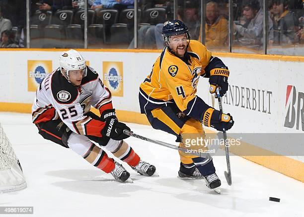 Ryan Ellis of the Nashville Predators skates against Mike Santorelli of the Anaheim Ducks during an NHL game at Bridgestone Arena on November 17 2015...