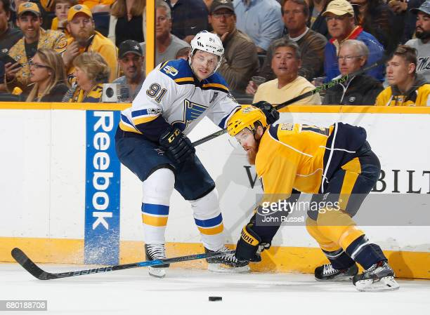 Ryan Ellis of the Nashville Predators skates against Vladimir Tarasenko of the St Louis Blues in Game Four of the Western Conference Second Round...