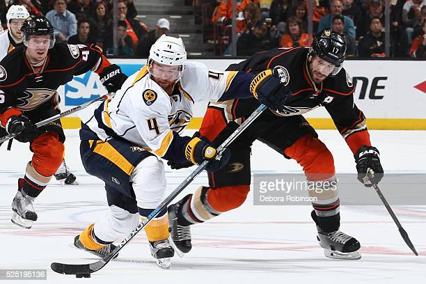Ryan Ellis of the Nashville Predators skates with the puck against Ryan Kesler of the Anaheim Ducks in Game Seven of the Western Conference First...