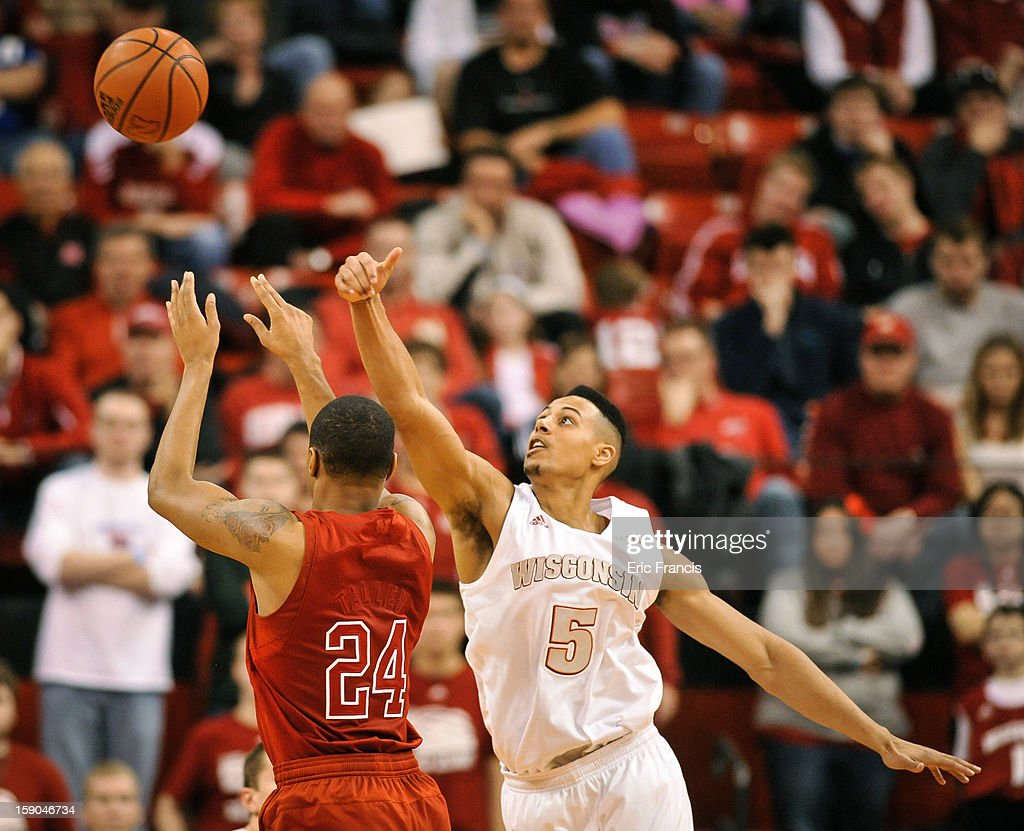 Ryan Evans #5 of the Wisconsin Badgers tips the shot of Dylan Talley #24 of the Nebraska Cornhuskers during their game at the Devaney Center on January 6, 2013 in Lincoln, Nebraska. Wisconsin defeated Nebraska 47-41.
