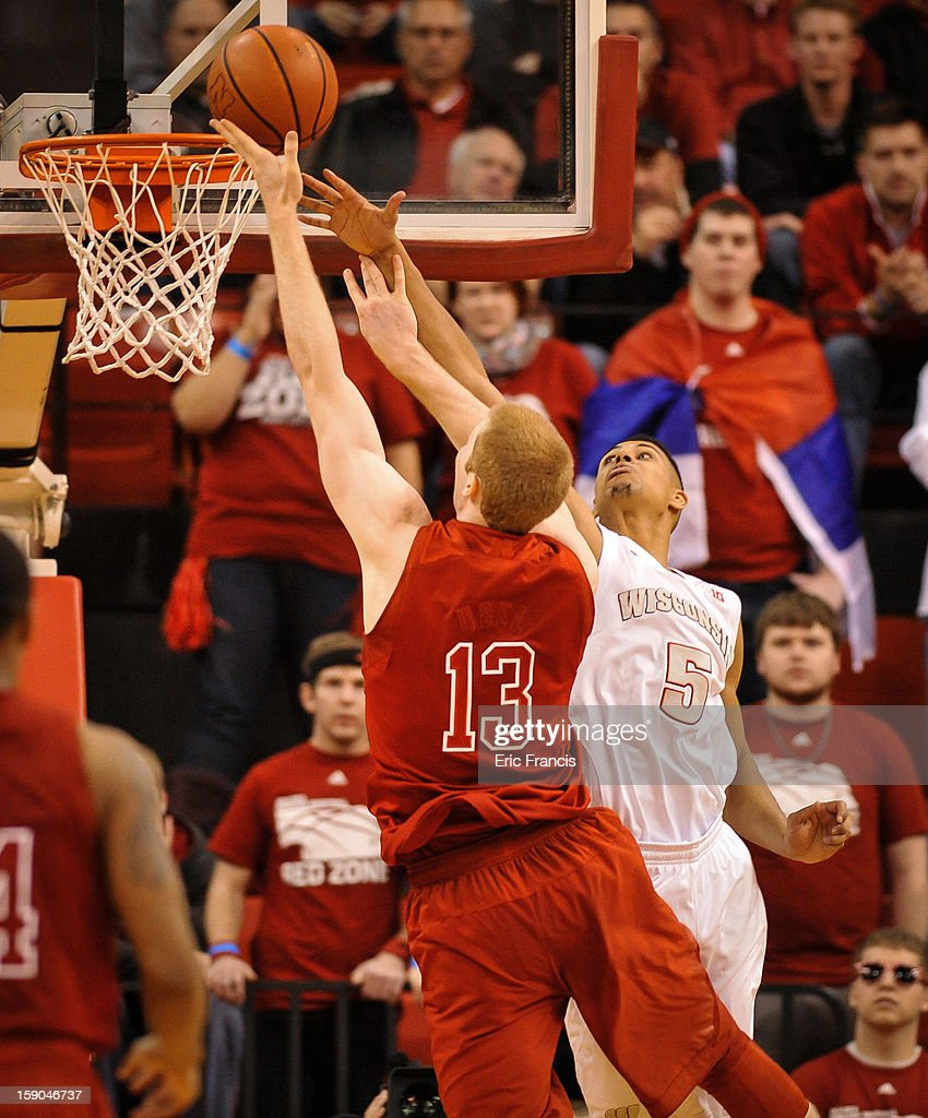 Ryan Evans #5 of the Wisconsin Badgers tries to block the shot of Brandon Ubel #13 of the Nebraska Cornhuskers during their game at the Devaney Center on January 6, 2013 in Lincoln, Nebraska. Wisconsin defeated Nebraska 47-41.