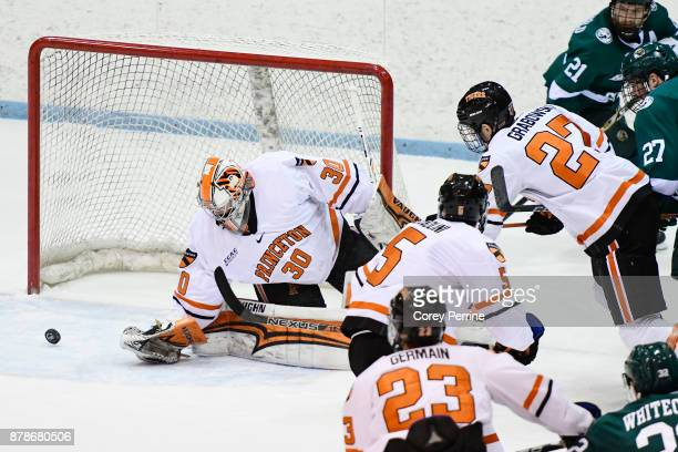 Ryan Ferland of the Princeton Tigers eyes a wide shot on goal against the Bemidji State Beavers during the first period at Hobey Baker Rink on...