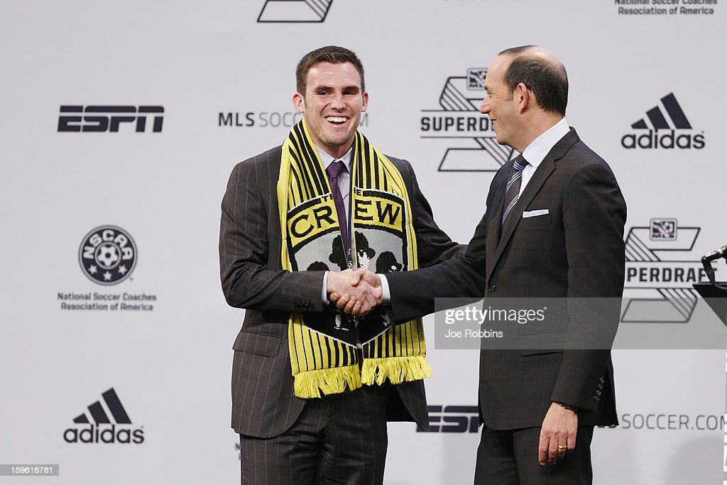 Ryan Finley (L) of Notre Dame shakes hands with commissioner Don Garber after being selected by the Columbus Crew as the ninth overall pick in the 2013 MLS SuperDraft Presented by Adidas at the Indiana Convention Center on January 17, 2013 in Indianapolis, Indiana.