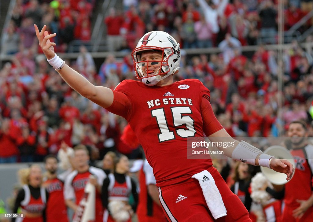 Ryan Finley #15 of the North Carolina State Wolfpack reacts after scoring a touchdown against the North Carolina Tar Heels during their game at Carter Finley Stadium on November 25, 2017 in Raleigh, North Carolina.