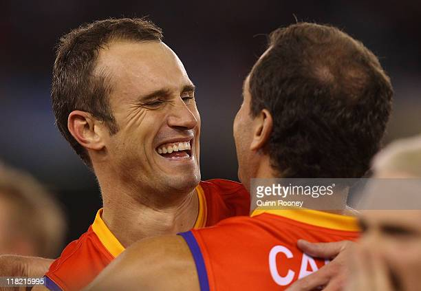 Ryan Fitzgerald and Wayne Carey of the All Stars hug during the EJ Whitten Legends Game at Etihad Stadium on July 5 2011 in Melbourne Australia