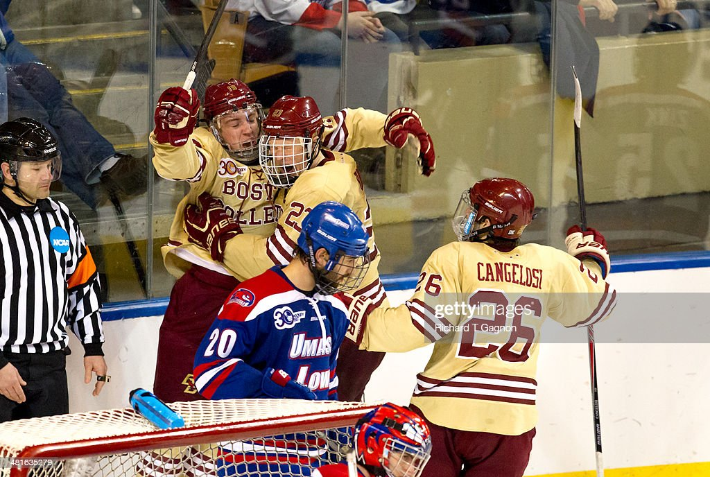 Ryan Fitzgerald #19 of the Boston College Eagles celebrates his goal with teammates Patrick Brown #23 and Austin Cangelosi #26 during the NCAA Division I Men's Ice Hockey Northeast Regional Championship Final against the Massachusetts Lowell River Hawks at the DCU Center on March 30, 2014 in Worcester, Massachusetts.
