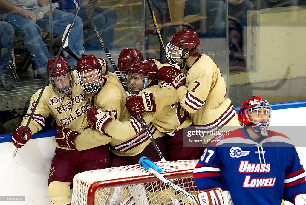 Ryan Fitzgerald #19 of the Boston College Eagles celebrates his goal with teammates Patrick Brown #23, Isaac MacLeod #7, Steve Santini #6 and Austin Cangelosi #26 during the NCAA Division I Men's Ice Hockey Northeast Regional Championship Final against the Massachusetts Lowell River Hawks at the DCU Center on March 30, 2014 in Worcester, Massachusetts.