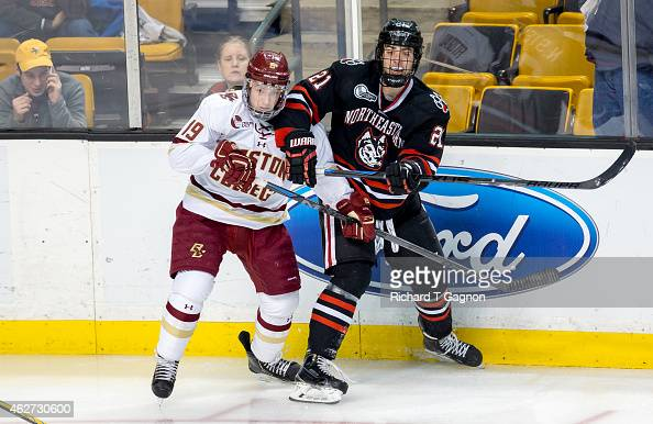 Ryan Fitzgerald of the Boston College Eagles checks Nolan Stevens of the Northeastern Huskies during NCAA hockey in the semifinals of the annual...