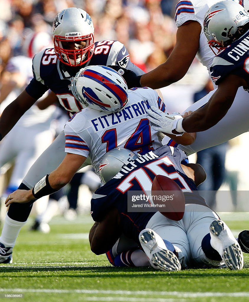 Ryan Fitzpatrick #14 of the Buffalo Bills has the ball stripped while being sacked by Vince Wilfork #75 and Jermaine Cunningham #96 of the New England Patriots during the game on November 11, 2012 at Gillette Stadium in Foxboro, Massachusetts.