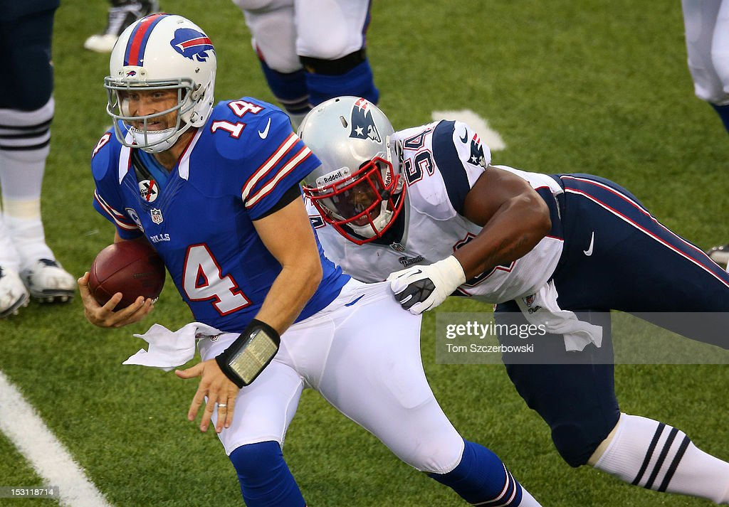 <a gi-track='captionPersonalityLinkClicked' href=/galleries/search?phrase=Ryan+Fitzpatrick&family=editorial&specificpeople=622098 ng-click='$event.stopPropagation()'>Ryan Fitzpatrick</a> #14 of the Buffalo Bills is tackled by <a gi-track='captionPersonalityLinkClicked' href=/galleries/search?phrase=Dont%27a+Hightower&family=editorial&specificpeople=5514947 ng-click='$event.stopPropagation()'>Dont'a Hightower</a> #54 of the New England Patriots during an NFL game at Ralph Wilson Stadium on September 30, 2012 in Orchard Park, New York.
