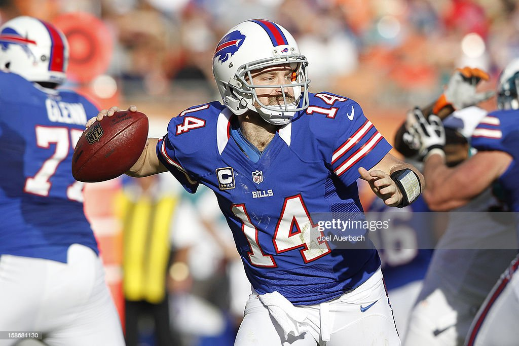 <a gi-track='captionPersonalityLinkClicked' href=/galleries/search?phrase=Ryan+Fitzpatrick&family=editorial&specificpeople=622098 ng-click='$event.stopPropagation()'>Ryan Fitzpatrick</a> #14 of the Buffalo Bills runs with the ball out of the pocket against the Miami Dolphins on December 23, 2012 at Sun Life Stadium in Miami Gardens, Florida. The Dolphins defeated the Bills 24-10.