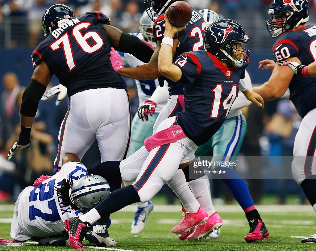 Ryan Fitzpatrick of the Houston Texans is sacked by JJ Wilcox of the Dallas Cowboys in the first half at ATT Stadium on October 5 2014 in Arlington...