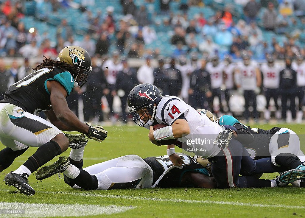 Ryan Fitzpatrick of the Houston Texans is stopped short of the goal line during the second half of the game against the Jacksonville Jaguars at...