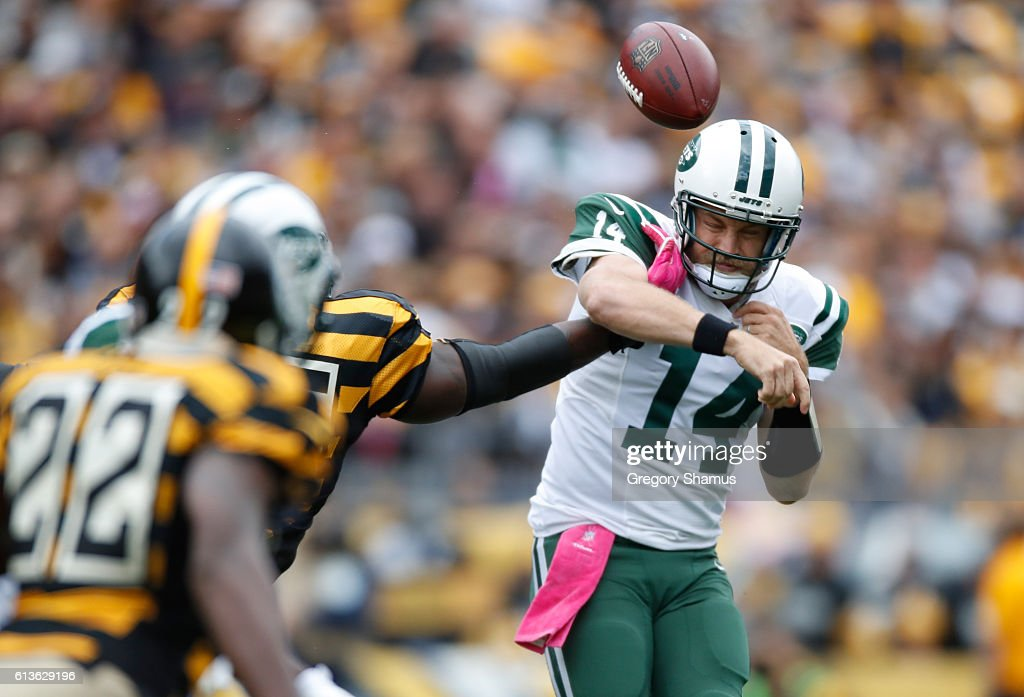 Ryan Fitzpatrick #14 of the New York Jets gets a pass knocked out of his hand during the first quarter by Arthur Moats #55 of the Pittsburgh Steelers at Heinz Field on October 9, 2016 in Pittsburgh, Pennsylvania. Pittsburgh won the game 31-13.