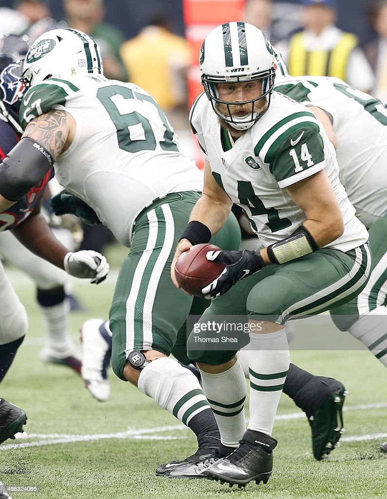 Ryan Fitzpatrick #14 of the New York Jets takes the snap from center while playing against the Houston Texans in the third quarter on November 22, 2015 at NRG Stadium in Houston, Texas. Texans won 24 to 17.