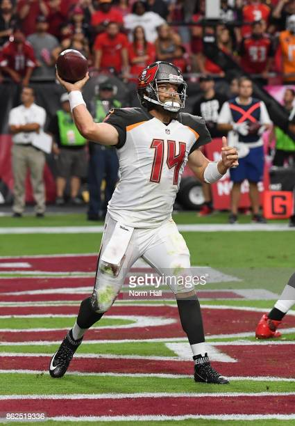 Ryan Fitzpatrick of the Tampa Bay Buccaneers looks to throw the ball out of his own endzone against the Arizona Cardinals at University of Phoenix...