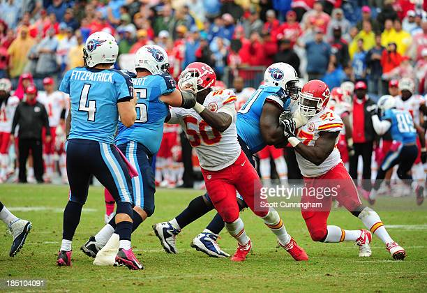 Ryan Fitzpatrick of the Tennessee Titans passes behind blocking by David Stewart and Chance Warmack against the Kansas City Chiefs at LP Field on...