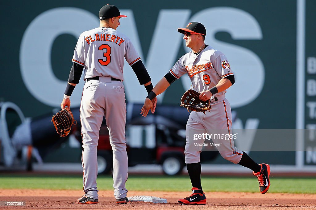 Ryan Flaherty #3 celebrates with David Lough #9 of the Baltimore Orioles after their game against the Boston Red Sox at Fenway Park on April 19, 2015 in Boston, Massachusetts. The Orioles defeat the Red Sox 8-3.