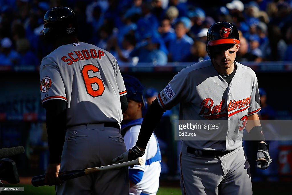 <a gi-track='captionPersonalityLinkClicked' href=/galleries/search?phrase=Ryan+Flaherty&family=editorial&specificpeople=4412528 ng-click='$event.stopPropagation()'>Ryan Flaherty</a> #3 of the Baltimore Orioles celebrates with <a gi-track='captionPersonalityLinkClicked' href=/galleries/search?phrase=Jonathan+Schoop&family=editorial&specificpeople=2526897 ng-click='$event.stopPropagation()'>Jonathan Schoop</a> #6 after hitting a solo home run to right field against Jason Vargas #51 of the Kansas City Royals in the third inning during Game Four of the American League Championship Series at Kauffman Stadium on October 15, 2014 in Kansas City, Missouri.