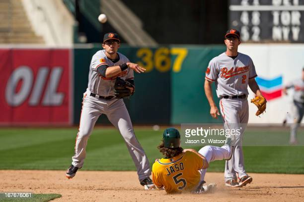 Ryan Flaherty of the Baltimore Orioles completes a double play over John Jaso of the Oakland Athletics to the end the game during the ninth inning at...