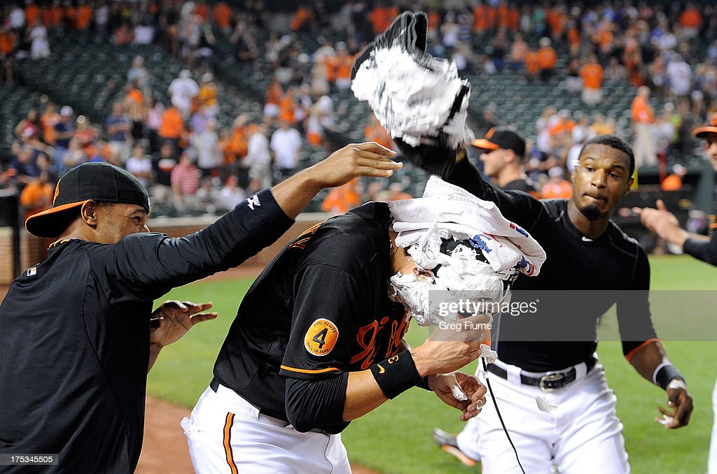 <a gi-track='captionPersonalityLinkClicked' href=/galleries/search?phrase=Ryan+Flaherty&family=editorial&specificpeople=4412528 ng-click='$event.stopPropagation()'>Ryan Flaherty</a> #3 of the Baltimore Orioles gets shaving creamed by <a gi-track='captionPersonalityLinkClicked' href=/galleries/search?phrase=Alexi+Casilla&family=editorial&specificpeople=4180372 ng-click='$event.stopPropagation()'>Alexi Casilla</a> #12 and Adam Jones #10 after an 11-8 victory against the Seattle Mariners at Oriole Park at Camden Yards on August 2, 2013 in Baltimore, Maryland.
