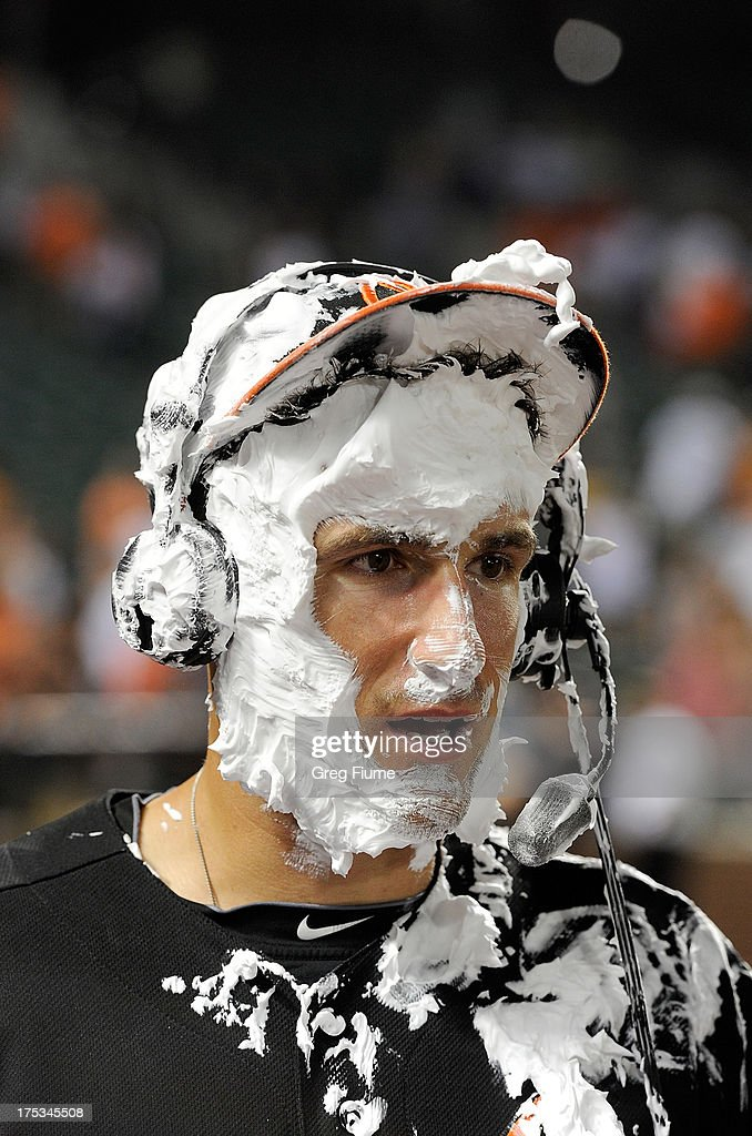 <a gi-track='captionPersonalityLinkClicked' href=/galleries/search?phrase=Ryan+Flaherty&family=editorial&specificpeople=4412528 ng-click='$event.stopPropagation()'>Ryan Flaherty</a> #3 of the Baltimore Orioles is interviewed after an 11-8 victory against the Seattle Mariners at Oriole Park at Camden Yards on August 2, 2013 in Baltimore, Maryland.