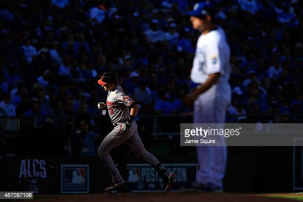 Ryan Flaherty of the Baltimore Orioles runs the bases after hitting a solo home run to right field against Jason Vargas of the Kansas City Royals in...