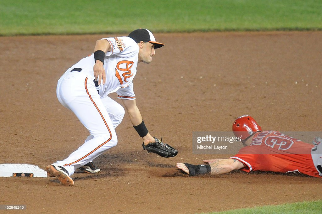 Ryan Flaherty #3 of the Baltimore Orioles tags out Josh Hamilton #32 of the Los Angeles Angels of Anaheim on a steal attempt at second base in the sixth inning during a baseball game on July 30, 2014 at Oriole Park at Camden Yards in Baltimore, Maryland. The Orioles won 4-3.