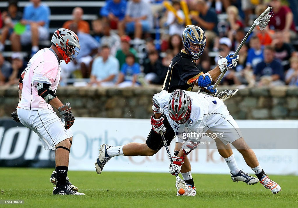 Ryan Flanagan #24 of Eclipse goes after a loose ball with Kevin Buchanan #27 of Supernova during the 2013 Major League Lacrosse All Star Game at American Legion Memorial Stadium on July 13, 2013 in Charlotte, North Carolina.