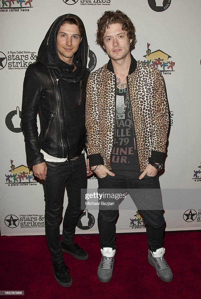 Ryan Follese and Nash Overstreet of Hot Chelle Rae attend 7th Annual 'Stars & Strikes' Celebrity Bowling And Poker Tournament Benefiting A Place Called Home at PINZ Bowling & Entertainment Center on March 6, 2013 in Studio City, California.