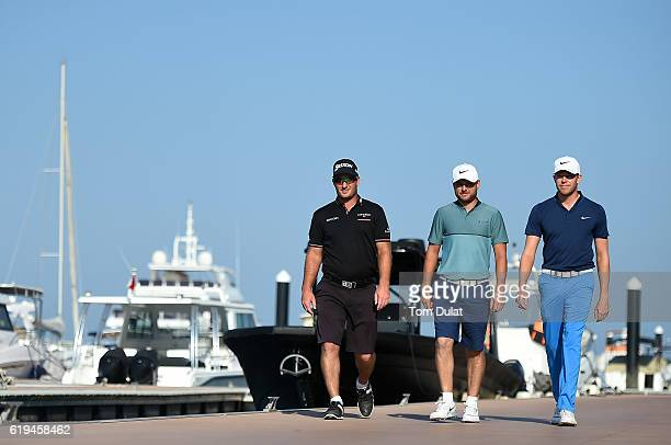 Ryan Fox of New Zealand Jordan Smith of England and Alexander Knappe of Germany walk in the marina during previews of the NBO Golf Classic Grand...