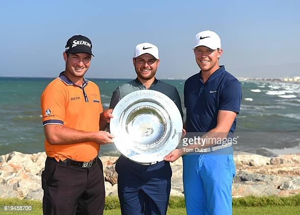 Ryan Fox of New Zealand Jordan Smith of England and Alexander Knappe of Germany pose with the trophy during previews of the NBO Golf Classic Grand...