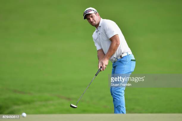 Ryan Fox of New Zealand lines up a putt on the 18th hole during the first round of the 2017 PGA Championship at Quail Hollow Club on August 10 2017...
