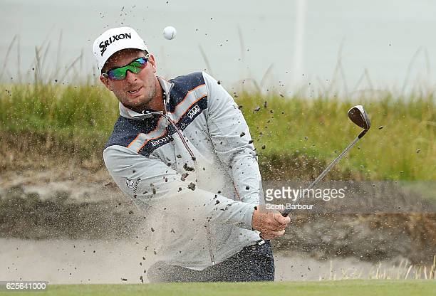 Ryan Fox of New Zealand plays out of a bunker on the 18th hole during day two of the World Cup of Golf at Kingston Heath Golf Club on November 25...