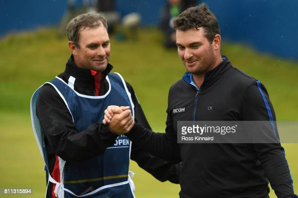 Ryan Fox of New Zealand reacts wit his caddie on the 18th green during the final round of the Dubai Duty Free Irish Open at Portstewart Golf Club on...