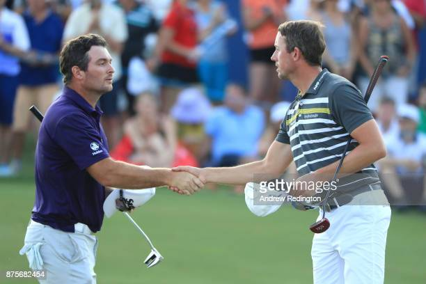 Ryan Fox of New Zealand shakes hands with Alexander Bjork of Sweden on the 18th green during the third round of the DP World Tour Championship at...