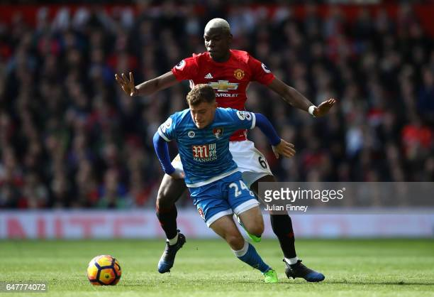Ryan Fraser of AFC Bournemouth and Paul Pogba of Manchester United battle for possession during the Premier League match between Manchester United...
